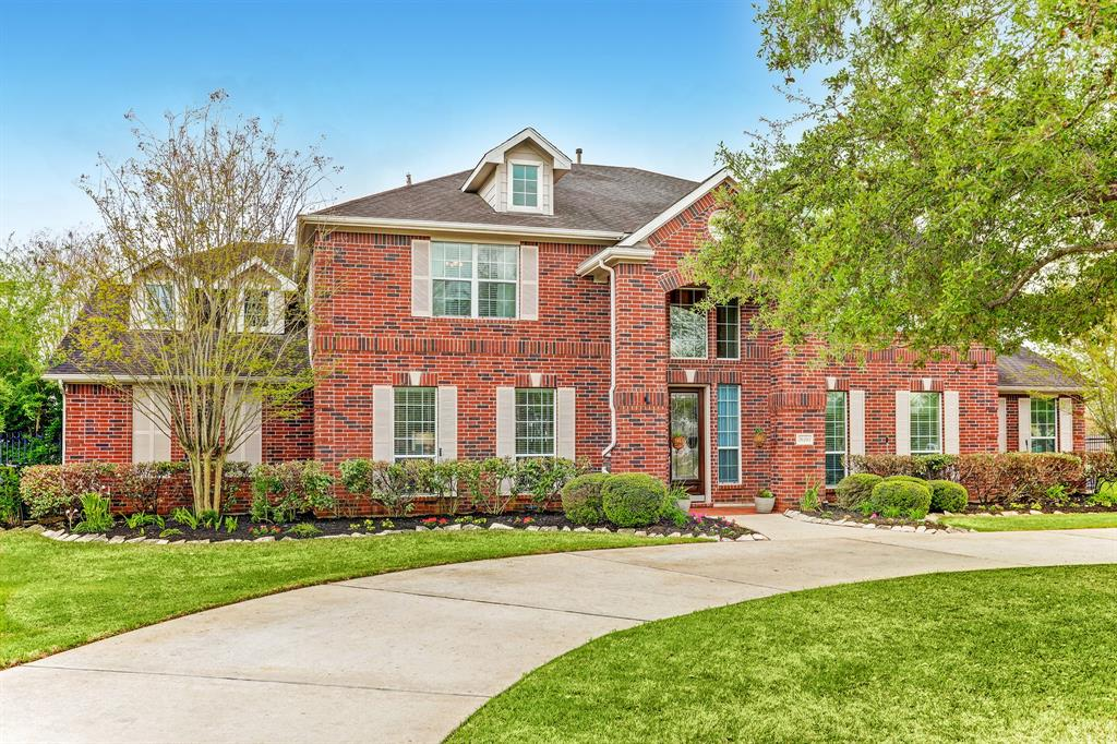 This large bright and open home is updated with new neutral interior paint April 2020-March 2021, New carpet Jan 2021, Updated stone fireplace and hearth Oct 2019, New wood floors downstairs March 2019, New kitchen backsplash April 2021. A large island kitchen with a breakfast bar in addition to a breakfast room is open to the two story den. Second primary up. A 5 car garage with 2 extra parking spaces behind an electric driveway gate in addition to circular drive out front. The 2 car detached garage and extra parking pads were added June 2014. A 32x20 covered patio added July 2009 attached to a 17x16 covered outdoor kitchen added April 2016. Utility room sink. Soaring ceilings. Art niches and crown molding. Primary plus study down. Utility room with sink.  Large open living and dining rooms flank the two story entry. 5 large bedrooms with walk-in closets up. A large game room adjacent to a large media room up in addition to a den area on the other side of the second level.