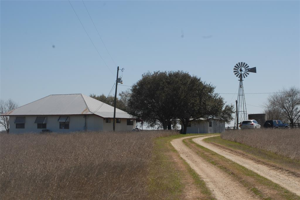 GONZALES FARM - Total 50 acres - This acreage and farm house are located approx. 6 miles from the city limits of Gonzales! The house, barn, sheds, windmill and 2 wells are on the 5 acre tract. The barn is 65' wide and 70' deep needing repair. The open shed is 35' deep x 70' wide. The adjoining 45 acres are ag exempt, perimeter fenced and have an abundance of wildlife. The pastures are improved with coastal grass where hay has been made for many years. This is the perfect place in the country away from the hustle and bustle of the city yet conveniently located 4 miles to I-10, and centrally located between Houston, Austin and San Antonio. Unrestricted! Come out and enjoy country living at its best.
