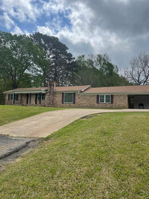 11.691 AC. – 5162 N US Highway 79 - Palestine, TX – COUNTRY LIVIN', CLOSE TO TOWN – Here is a hilltop country home on 11.691 acres featuring 4 bedrooms, 2 baths, 2 living spaces, and wide-open space in the kitchen & dining area.  11.691 beautifully timbered acres with several open areas featuring a few storage barns/buildings.  Large mature Pecan Trees, and several fruit trees.  This property fronts US Highway 79 and has frontage and rear access off County Road 367.  This home has had some remodeling and updates done over the years. Updated flooring, windows and doors, new roof put on 3 years ago.  This would be the perfect place to retire from the big city and have plenty of space for all those grandkids, or the perfect place to raise the family in the country with lots of space to roam. Give me a call today to set up your personal showing.  Trust me you don't want to miss out on this opportunity.