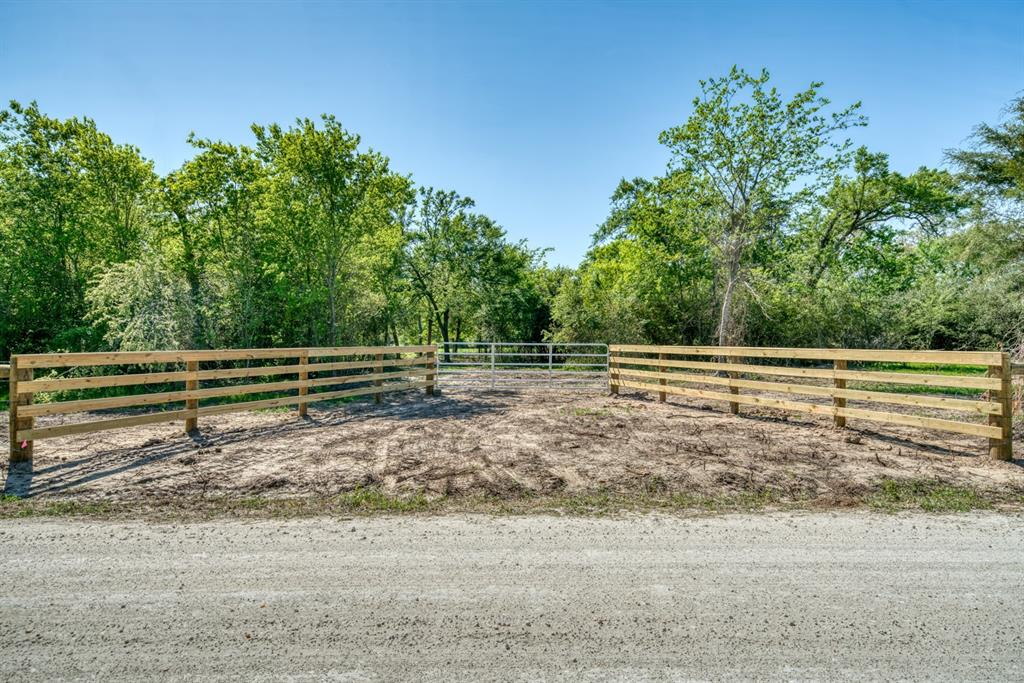 Located only 12 miles from I-45 in Madison County lies 28+/- acres ready for a full-time country estate or your weekend retreat. Fully fenced property with approximately 1,250 feet of road frontage and an established entrance. The property consists of 80% wood, 20% pasture, mature oaks, a 1/2 acre stocked pond, an abundance of wildlife, and a beautiful cleared home site ready for your new home. Currently, there are no utilities in place, and restrictions do apply.