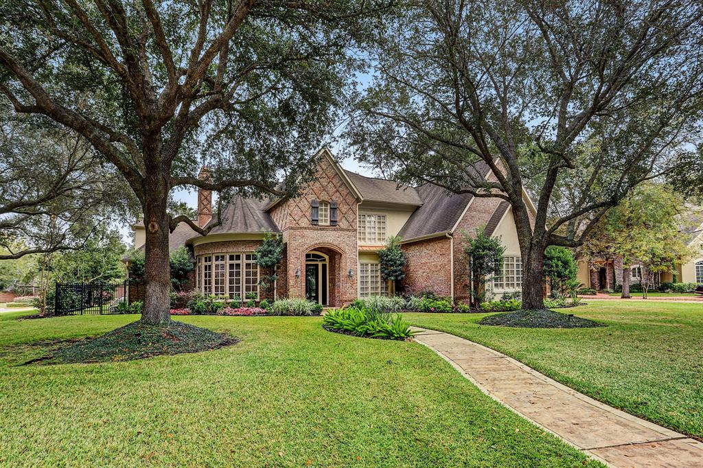 Lovely secluded custom home hidden away in gated neighborhood of Bayou Park Estates of only 10 homes located on an over 24,000 SF (FBCAD) corner lot with access to walking trails along the bayou. Leaded glass front door leads into a 2 story entry with sweeping staircase. Private study has built-ins and fireplace. Elegant, large, bright dining room leads to butler's pantry and wet bar. Open island kitchen with granite counters and walk-in pantry. Family room has a cozy fireplace and lovely backyard views open to the kitchen/breakfast rooms. Updated primary bath, two walk-in closets with built-ins. Primary suite has access to the patio and pool. Covered patio overlooks gorgeous pool with waterfall and spa. Four additional bedrooms, game room and flex room up. Three car garage has epoxy floor and storage cabinets. Oversized utility room. Plantation shutters throughout. Close to shopping, restaurants, golf course. Don't miss this terrific home. All info per seller.