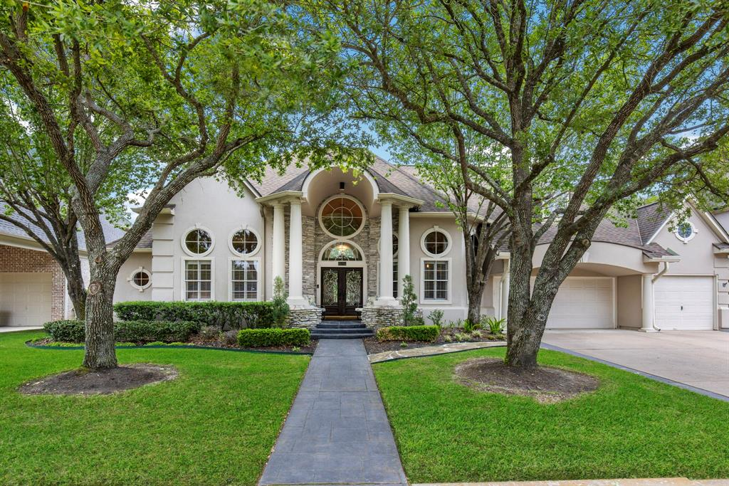 Gorgeous 1.5 story home on Golf Course with pool in Gated Community! This beautiful home has wood floors throughout except secondary rooms, granite counters, plantation shutters, high ceilings, barrel arch, and walls of windows. The primary suite is spacious w/a sitting area, & the primary bath has Quartzite counters, oversized shower, free standing tub, sconce lighting, & a custom closet.  The kitchen is every chef's dream with it's gourmet appliances, large breakfast bar w/island & white cabinets finished w/a travertine backsplash.  The formal dining is stunning & equipped w/butler's pantry & wine cooler. Secondary rooms are huge w/ensuite baths & walk in closets. The formal living offers cast stone fireplace & gorgeous views of the incredible backyard.  The sparkling pool is surrounded with flagstone patio and waterfall rocks with gorgeous views of golf course. Finished off with 3 car garage + storage space, water softener, central vacuum & 3 AC units.  This is the perfect oasis.