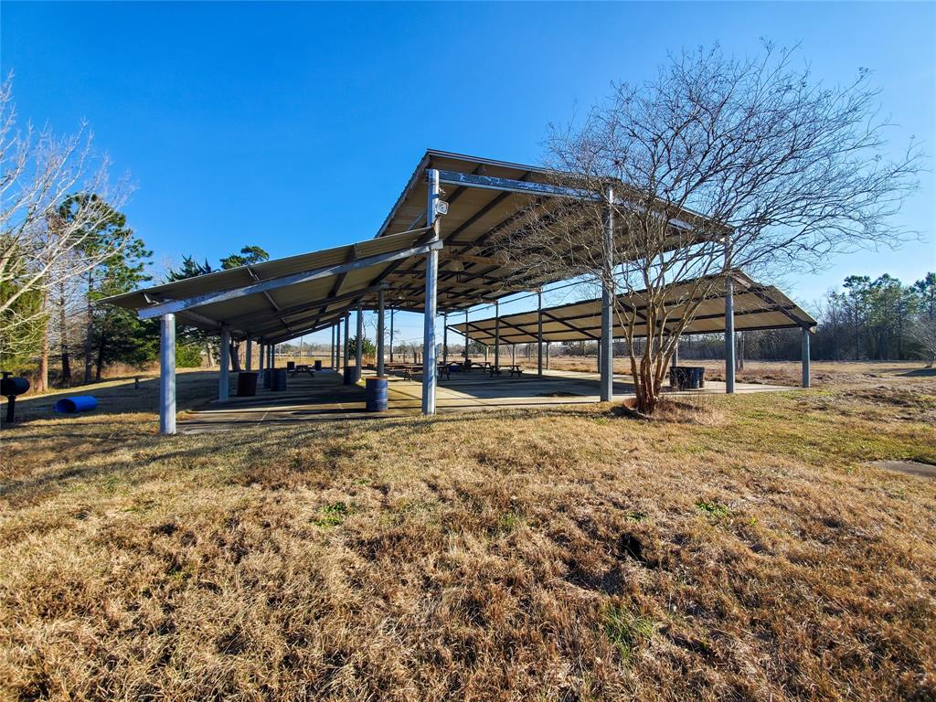 Awesome 7.5 acres right next to Hwy 3 and minutes from I 45. Close to Galveston and Houston. Property currently has brick building with restrooms. Humongous conrete slab with covered awning. Already has water, sewer and electric to property.