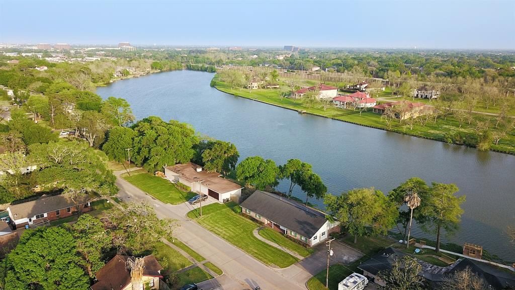 """This idyllic lake retreat on 1/3 acre lot in the heart of historic Sugar Land is truly a rare find. Experience the incredible breezes from the elevated deck as you gaze out on Cleveland Lake and the beautiful homes and Pecan trees across the lake in The Orchard. This historic one owner home was designed and built in 1959 on one of the prime Cleveland Lake lots.The home has many updates and improvements including a recent roof and PEX plumbing! Living on a large waterfront lot only 20 minutes to the Galleria or Med Center is the ideal situation for those wanting a little space yet wanting to enjoy all that the city of Houston has to offer as well. """"Old Sugar Land"""" or """"The Hill"""" as it is sometimes called is most definitely a place to call home!"""