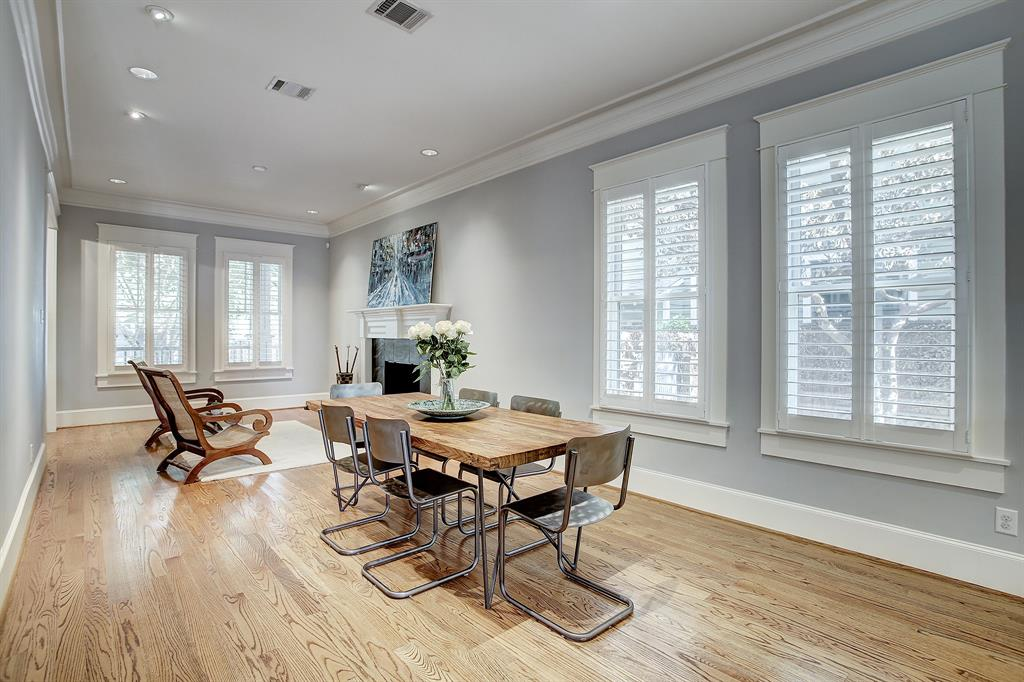 This perspective best shows how spacious is the combo living/dining area. And so bright! Also of note, the side yard out the windows across from the table provide nice separation from the property next door.