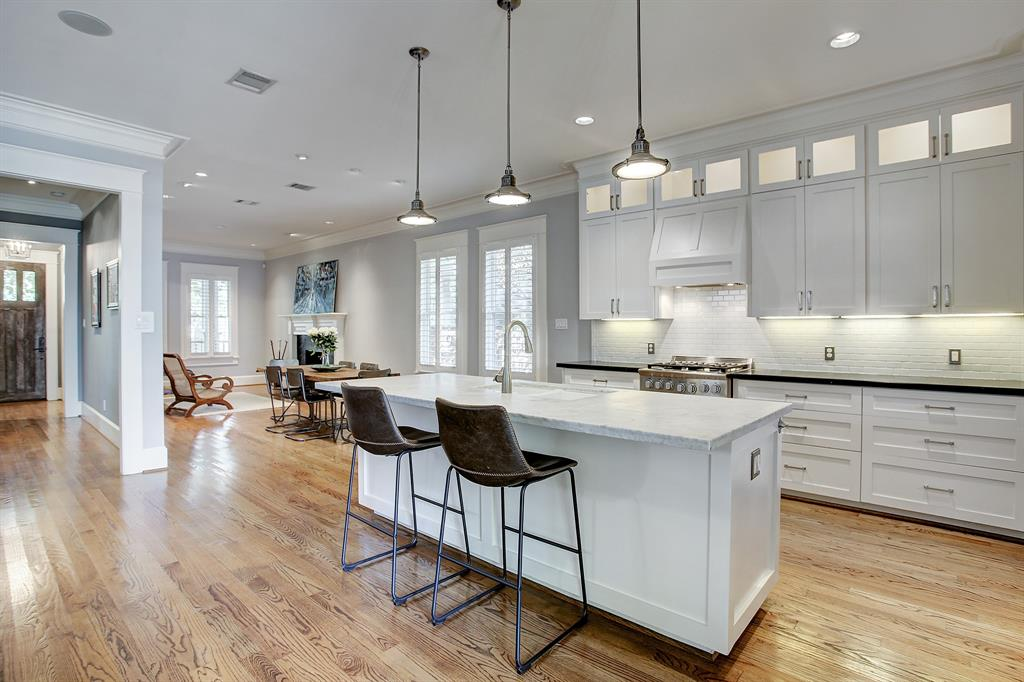 The kitchen island with a double bowl white sink includes a breakfast bar/overhang that will comfortably allow four stools.