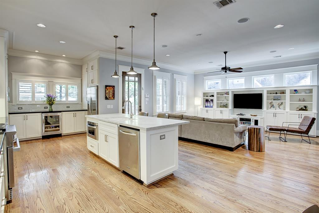 This is the dream open concept kitchen and living area, with direct access to the back porch and yard!