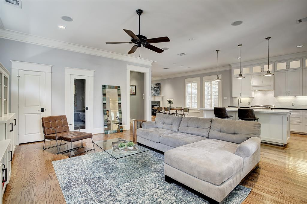 The family room allows for big, comfy furniture and a variety of configurations. An additional bonus in this home is a wine room (approximately 5 x 3) behind the glass door. The door to the far left offers an additional closet and tremendous storage space under the staircase.