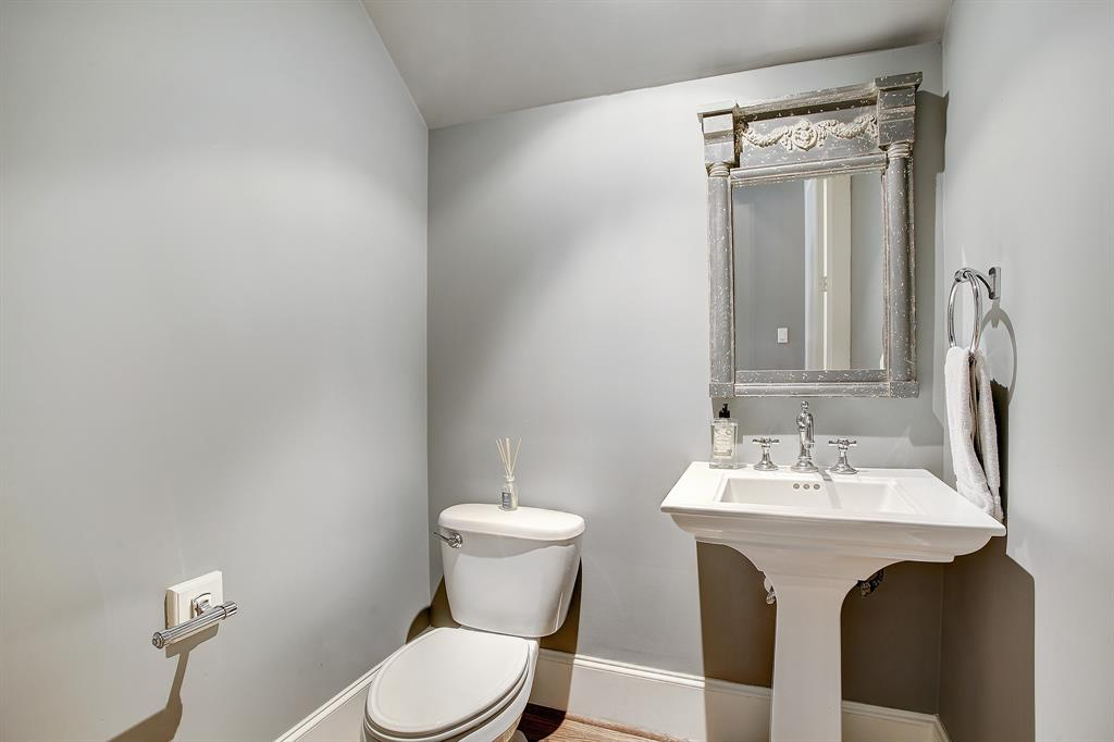 Finally on the first level in the hall leading from the front door to the family room is a half bath with classic finishes. In the same hall is a coat closet.