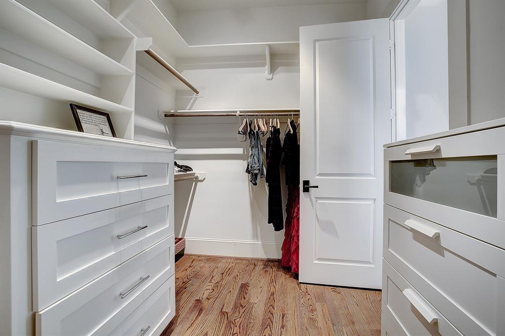 Finally, the primary suite includes a very big custom walk-in closet with one built-in dresser (on the left). This closet is accessed from the bath.