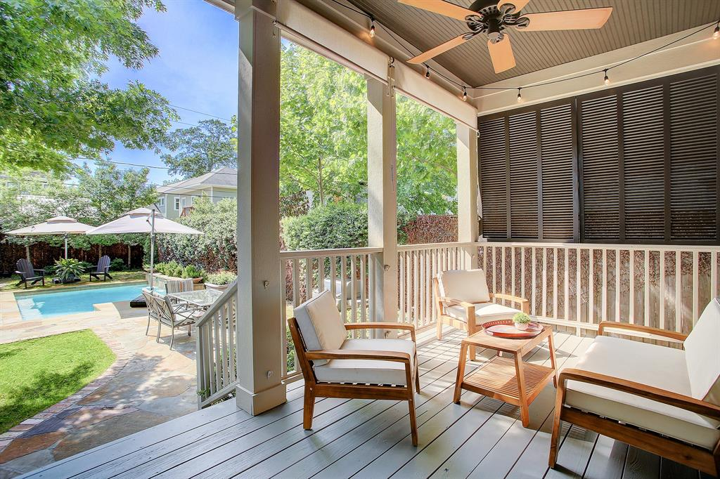 The absolute oasis of a back yard begins when you step out onto the covered back porch from the family room.