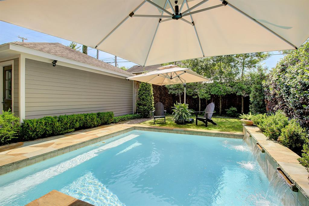 There is also yet more exceptional space to enjoy at the far end of the pool, and a gate at the back side of the garage leading to the alley.