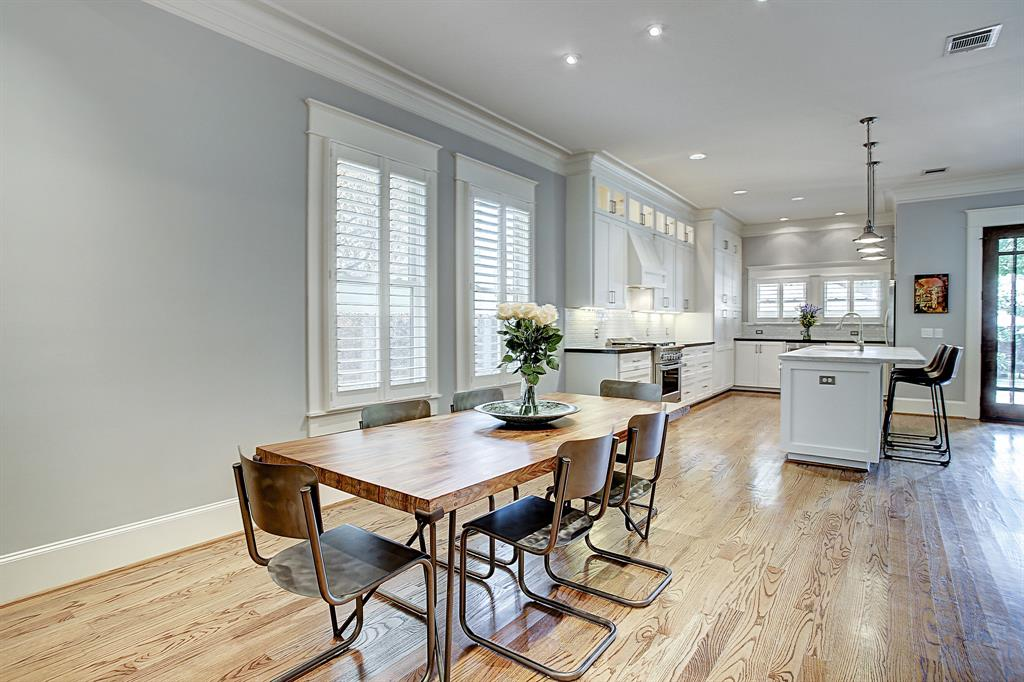 Just beyond the formal living is a dining area with ample room for a table of at least eight people, as well as a sideboard, buffet, etc.