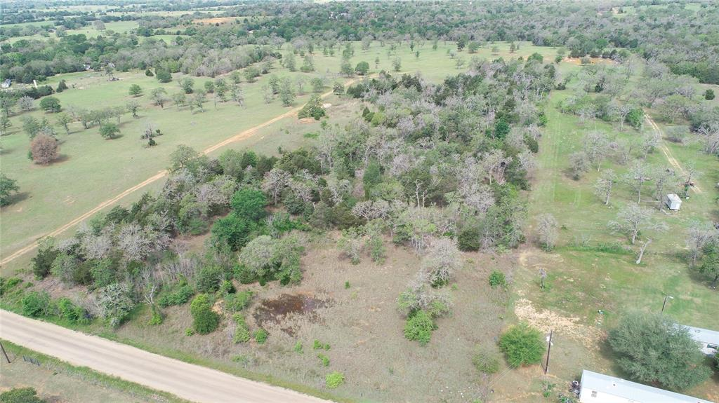 Looking for a secluded 6 ac. for a weekend getaway place, mini farm, or recreational property? This is the perfect small piece of property with pretty country views! Heavily wooded throughout the middle of the property provides many options for your homesite and wildlife to view. Fencing on back side of property. Road frontage is a county road. Water and electricity accessible. No exemptions at this time. Unknown if mineral lease. No minerals convey.