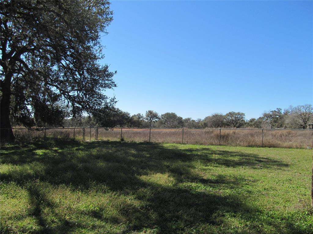 Great property with loads of potential. This property currently provides 2 homes, multiple out buildings, a pond, walking distance to Splashway Water Park, quick access to Hwy 90-A, and a short distance to Interstate 10. The home has a simple lay out with 2 bedrooms and a bath on one side of the home & on the other, an open living dining concept & a vintage kitchen. Off the kitchen is a bonus room that runs the width of the home with a 2nd bath & laundry area. Outside is a covered deck, covered parking, a bonus space that is waiting for the new owner's creativity, a small pond, & cross fencing. The guest house has its own address & is a 12'x51' mobile home built in 1967 with 2 bedrooms & 1 bath. The home is cross fenced with own entrance from main house & has 3 out buildings & covered parking for equipment or an RV. The property provides multiple use potentials for investors as residential, commercial and/or ag usage. Don't miss out on this opportunity call today to schedule a showing