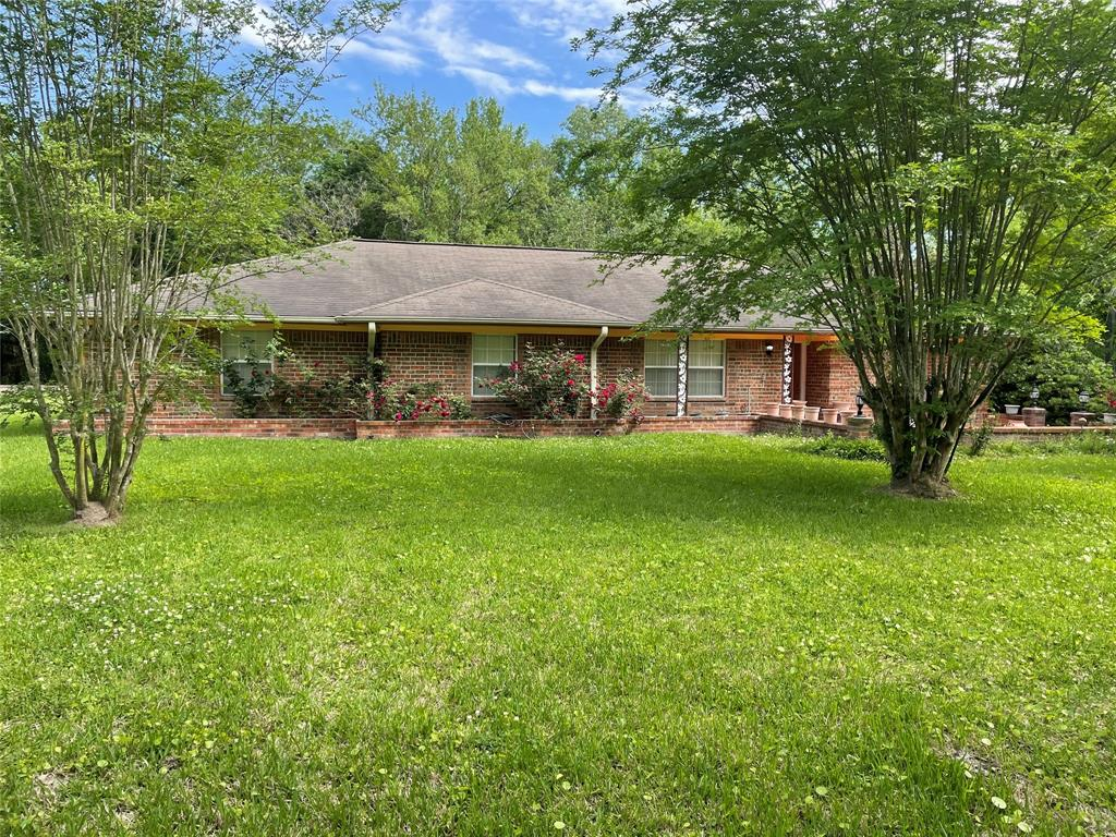 HUGE 2.41 acre property located in Houston.  No HOA.  Has 4 bed/2 bath with formal dining area.  All brick one story.  Tile throughout house.  All rooms good sized.  Still mostly wooded area.  Has slab and piping for another structure to be built behind home.  Can be used for residential or a business.