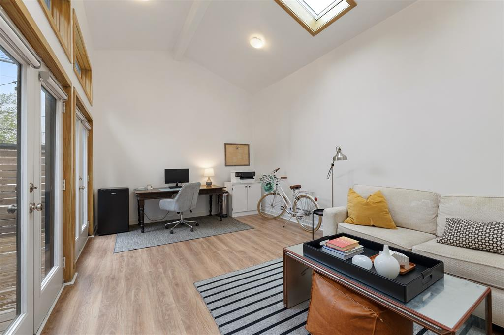 Besides the wall of windows overlooking the patio, this flex space also includes 2 skylights. Per the seller, the floors were replaced in 2019.