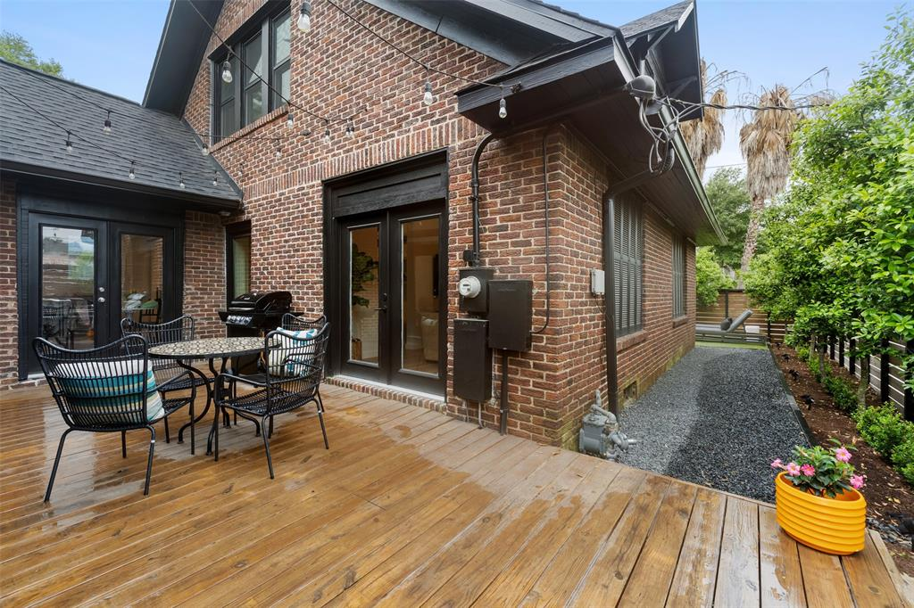 Accessible from the living area and the kitchen, this back patio is a great space for outdoor dining and grilling.