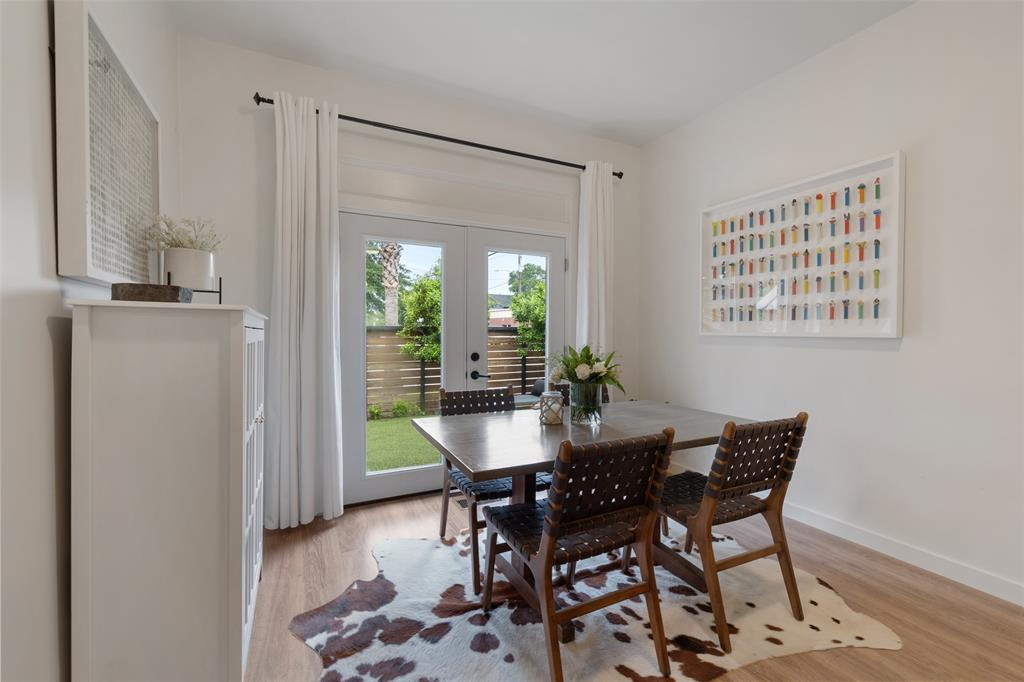 This dining space is located just off the living room and overlooks the courtyard. This flexible space could also serve as a sitting or study area.