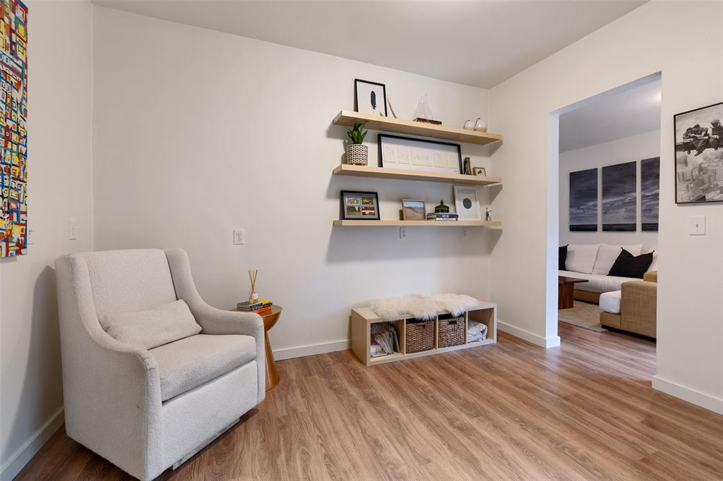 Located off the living room you will find this great sitting area. Like the dining area, this flexible space has lots of options. It could serve as a study or the main dining area. Per the seller, the floors, like the ones in the kitchen and the living room, were added in 2019.