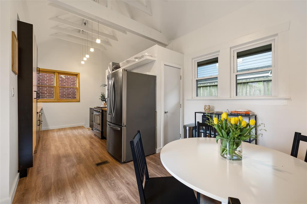 The kitchen offers a large breakfast area and lots of natural light.