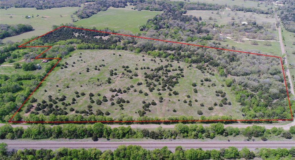 This 10 acre is Tract 2 in the new John Elsie Estates Subdivision has a ton of potential to be a beautiful homestead in the community of Chriesman, 7 miles north of the city limits of Caldwell and 40 mins to Bryan-College Station. Lightly restricted to protect your investment, no mobile homes allowed. Electric onsite and county water available at CR 308. Not in flood zone. Electric easement. No minerals. Ag Exemption.