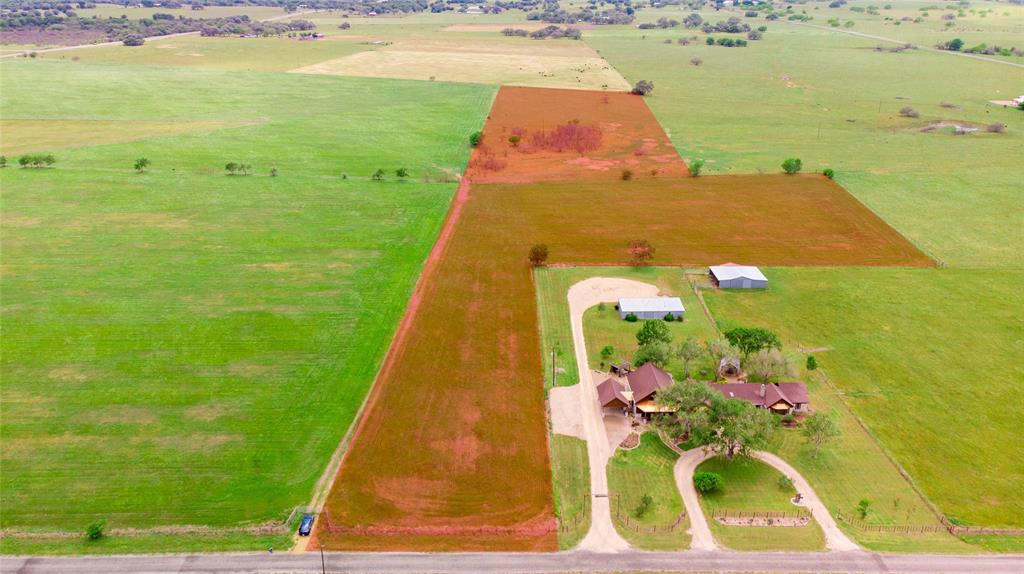 This PRIME piece of acreage is perfectly situated halfway between San Antonio and Houston, just under an hour from some of the best saltwater FISHING on the Gulf Coast! 13.2 acres currently under AG EXEMPTION with paved county road frontage, paved 1/4 mile off 77A highway.  Some fencing in place. NO FLOODING, half in grass, and half pasture.  A great homesite location too. Unrestricted and ready to be developed into what you want!