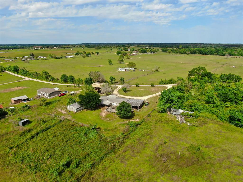 UNRESTRICTED 20 ACRES in Navasota with close access to Hwy 6.  Get away from the fast-paced city life and enjoy this peaceful property.  Minutes away from many conveniences.  Detached garage is 24 x 24 with a 6 inch slab, set up for welding.  RV station with private septic.  Small pond for livestock.  3/2 Mobile sold as-is, features metal roof, carport and 4 ton a/c.  Make your appointment today!  Professional photos to come.