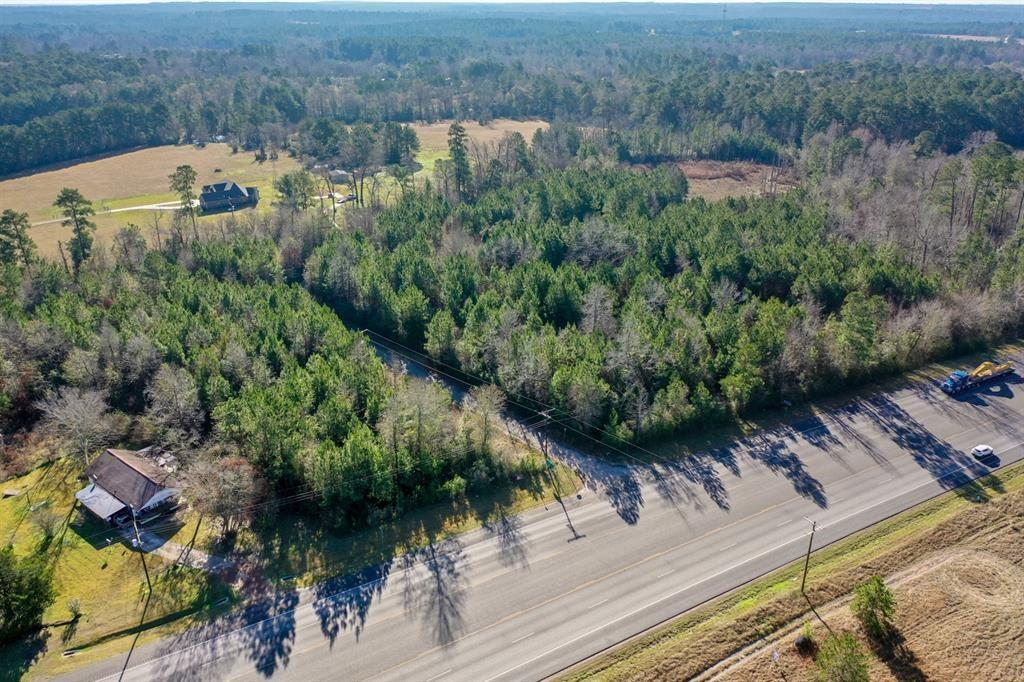Come build your dream home! This stunning 5.9 acre property has just about everything you could want for a picturesque Home-site. Featuring approx. 500 ft of road frontage along Hwy 59, as well as frontage on both sides of Providence Church Rd, there are endless possibilities to build. If a new Home-site is not what you have in mind, then take advantage of the many Commercial opportunities a place like this can provide as your new business location. Also being offered with the chance to split the property up into 2 separate tracts along Providence Church Rd. Come see the possibilities today!