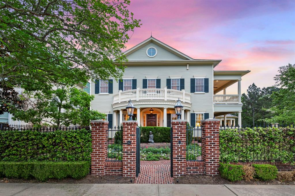 Beautiful Charleston style custom home in East Shore. Impeccable landscaping in a gated yard with brick columns and pathway leading to entry. Step inside this home to see all the intricate details. Wood floors flow throughout the downstairs. Formal dining and living both feature luxurious touches from the chandeliers to the details on the crown molding. Light and bright kitchen has white cabinets and wood finish on the island with sink looking out into living. Spiral stairway looks up to painted dome ceiling. Upstairs are 3 bedrooms with ensuite baths, including the primary suite with a spacious primary bathroom. Also upstairs is the laundry room and game room which opens up to study - all with beautiful wooden built-ins. 2-story porch has access points from multiple rooms on both the 1st and 2nd story. 3 car garage and gazebo space with a built-in grill for entertaining. The details of this home are a must see in person - schedule a showing to see for yourself!
