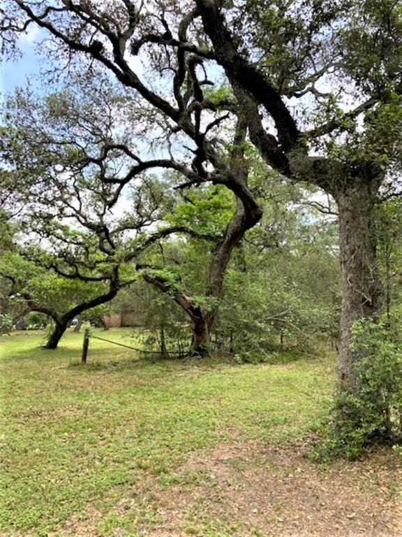 Pretty, wooded 7 acre parcel in quiet area of Wharton County a few miles off of US 59 for an easy commute to El Campo and surrounding areas such as Lake Texana where you can enjoy camping, fishing and sight-seeing.  There is a small cabin on the property that provides well, septic and electricity already in place to build your new home.    Nice topography, gorgeous oaks and lots of deer and other wildlife.