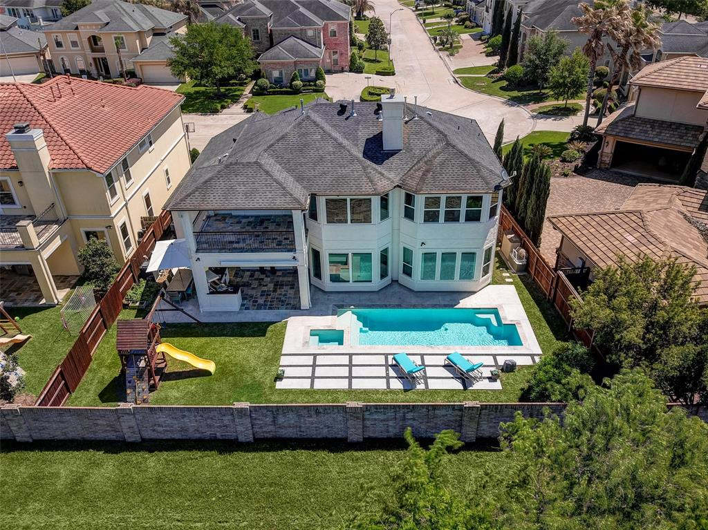 BACK ACTIVE!! Only showings Thursday 10th from 12:15-2:00 pm. Buyer wasn't able to secure a loan.  Showings start Thursday June 10th. Tenant occupied. Stunning property with a soft contemporary style inside Lakes of Parkway manned gated community. Features clean lines, top of the line appliances, lots of natural light, pool, 4-5 bedrooms, sought after secondary bedroom down, media room and lots more....