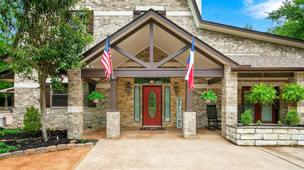 This charming Country Estate is tucked quietly away on 3+ beautifully wooded acres & just minutes from schools, shopping, & Lake Conroe. The home is designed for someone who likes to entertain & have guests stay for days. There's plenty of room with 2 Primary suites on the 1st floor, Garage Apartment & Guest Quarters.  It's so luxurious, you'll feel like you're staying at a resort.  The gourmet Kitchen is a Cook's delight; so whether you're cooking for 1 or a big crowd, state of the art appliances & lots of counter & cabinet space will make cooking a snap. The large Family Room has a corner floor-to-ceiling Fireplace & windows across the back that show case the lavishly landscaped yard. It's an outdoor paradise with covered veranda, multiple decks & fully stocked Pond. There's also a Party Pavilion with plenty of room to dance & mingle. This home has it all, including a Workshop with A/C & Air compressor,  perfect for your next project. Too many extras to list.  See it today!