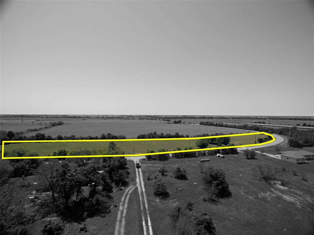 This is a 7.911 acre of cleared land with no trees.  Perfect for home and barn or shop.  High and dry, not in flood plain.  Buyer will need to obtain a survey.