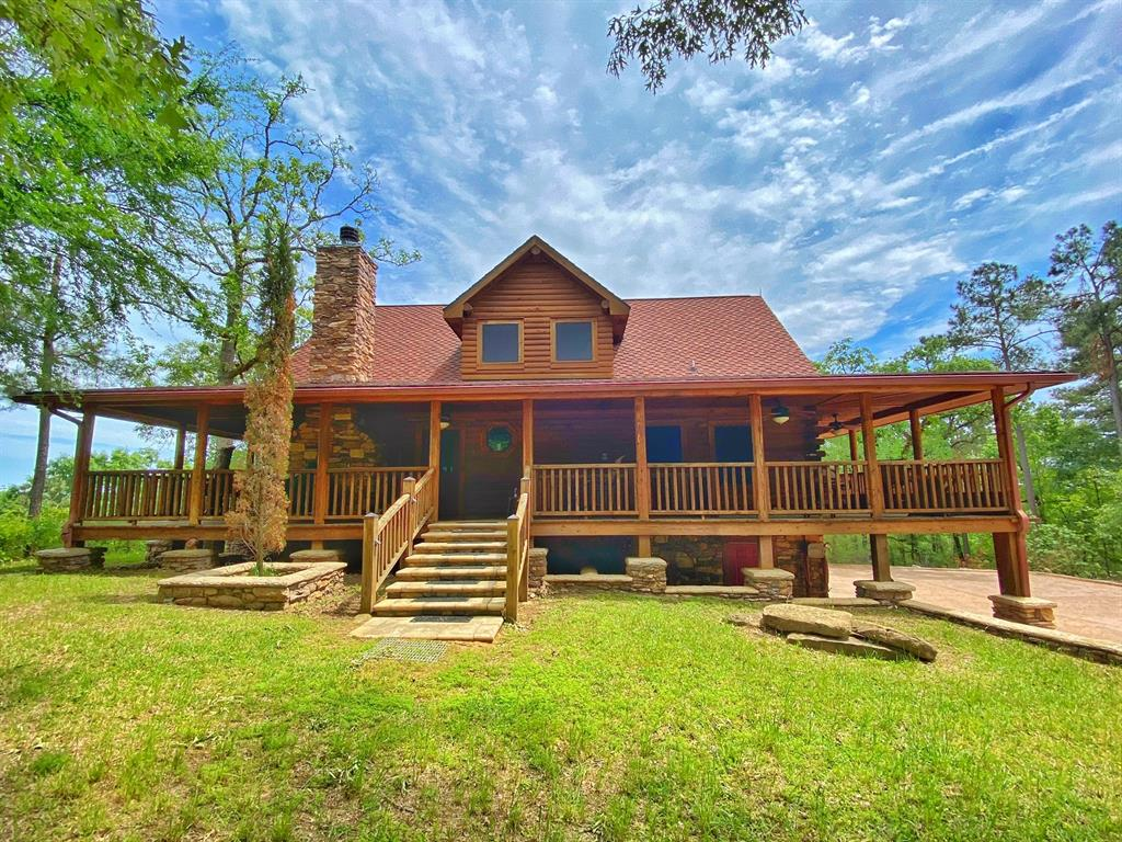 75 acre private ranch with gated entry, featuring rolling hills, mix of timber and pasture, 1/2 mile of stabilized interior roads, 1-acre stocked pond and access to year-round, spring-fed Boggy Creek. The crowning jewel of the property is the 3 story log house that sits on a 100 ft. bluff with unmatched views. The property has been very neatly maintained and well kept. As you enter the property, a large, 2 story barn with living quarters is showcased on a hill. Attention to detail was made in each aspect of the barn and the quality is unmatched. Excellent privacy and ease of travel are throughout the ranch. Both the cabin and living quarters in the barn are being sold furnished.