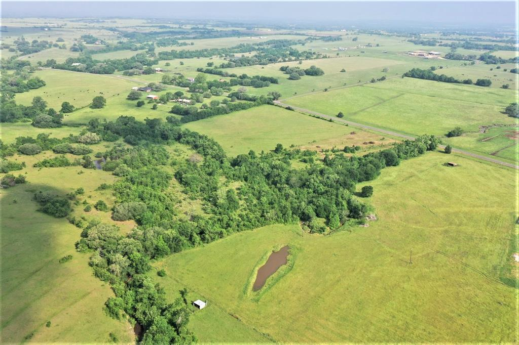 19.28 Acres Located on the LaBahia Trail (Scenic Highway of Texas) in the historical Independence/William Penn area. Rolling terrain, views, pond, creeks, long road frontage, nice combination of wooded and open meadows. Several nice building sites.  Beautiful trees along meandering creek with rock outcroppings and swimming holes. Parts of property are in the flood plain because of the creeks, see attached. Agricultural exemption for prior cattle grazing, in the process of changing to another ag use by Seller.  No restrictions.  You can build or set up your RV or mobile home and run your business. Partially fenced with metal gates. East property line is not fenced and the neighbor property has an old well pad that looks abandoned. County water line was run to this property from Ellerman Road years ago when Seller thought of building a home, Bluebonnet Electric service towards back of property. Seller reserves minerals and will convey all surface rights. No mineral lease.