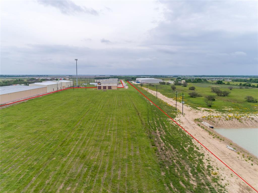 LOCATION LOCATION LOCATION!!!, 11.501 acres of PRIME land with new 5000 sf warehouse. Located in Rosenberg, Tx off of TX-Spur 10 Industrial area and 20 miles south of Houston, Tx.  Commercial / investor opportunity for new business, etc., the possibilities are endless! Warehouse has (5) 16' x 16' and (1) 14' x 16'  bay doors. New owner can create their own office space or utilize as is.