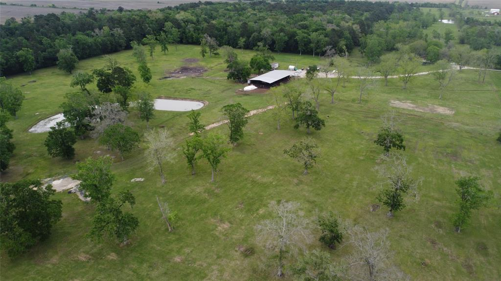 Country at its finest only 3 miles from Toll Rd 99.  75.94 acres nestled at the end of the road. Fenced and cross fenced for all of your livestock needs. Huge plantation Oaks and Native Pecans. Modest 1483 sq ft, 4Bdr/2bath farm house. Stocked lake with Catfish and perch. 60x114 Main barn with 10x24 office, 2 heated/ac controlled rooms, 10x20 feed room, wash rack and multiple pipe pens. 14x78 Trailer cover off side of barn. Additional 15x40 barn in back pasture. Improved pasture on most of the property. Private water well. Crushed concrete and limestone driveways. If you want a turnkey working farm, Come Build your Dream Home !!!!