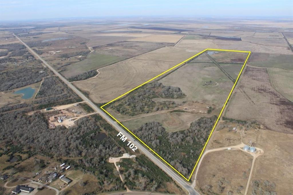 200 acres.  Front is wooded, rear is open land.