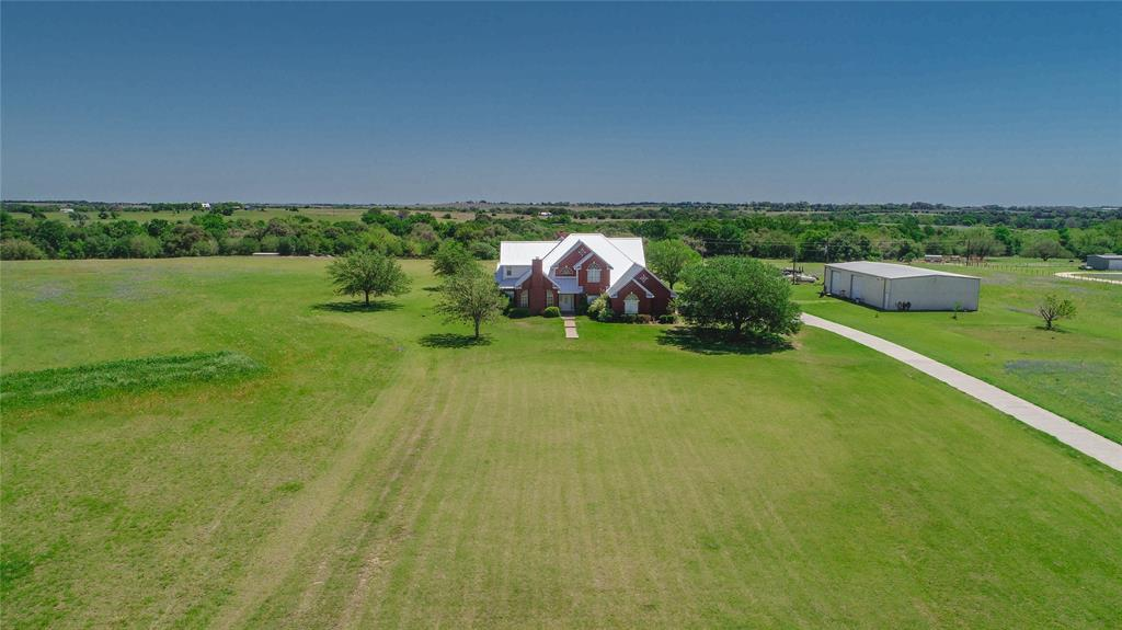 LOCATION! Hilltop Setting near Gay Hill community in Washington county, 10 minute drive to Historic, Downtown Brenham! 17.6 Acres, Ag. Exempt, Automatic Entry Gate & Concrete Driveway. 4,325 Sq.Ft.,2-Story Home. Slab of Home has approx. 50 11-Ft. Bell Bottom piers under slab. Standing Seam Metal Roof - 1 year old. 4 Bedrooms, 3.5 Bathrooms, Study w/ Fireplace, Formal Dining,Great Room w/ 18-Ft. Vaulted Ceiling, Austin Stone Fireplace & access to Wet Bar. Kitchen Features 9'x4' eat-in Island w/ sink and storage, Stained Wood Cabinets, Walk-in Pantry, Double Ovens, Recessed LED Lighting, Double Sink, Built-in Desk area w/ overhead cabinets & Breakfast Room. Primary Bedroom En-Suite w/ Walk-in Tile Shower, Jacuzzi Tub, Toilet Room, His & Hers Closets, Two Sinks and sit-down area at vanity. 2nd Story-2nd En-Suite Bedroom w/ Shower, Walk-in Closet, Split Floor Plan w/ Bedroom 3&4 having Jack/Jill Bathrooms. 40x75 Metal Building on Slab w/ 2 automatic overhead doors. 3 covered 8x8 kennels.