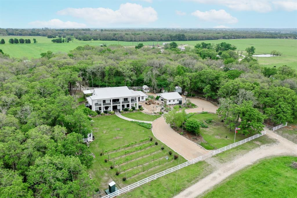 Breathtaking country estate situated on 38.5 acres in Brazos County! Soak in the breathtaking sunset views for miles on the upstairs Veranda or your screened in Amish Country gazebo. Amazing attention to detail and one of a kind features throughout the home. 7' Schonbek crystal chandelier in foyer with matching 2' chandelier and wall sconces in the formal dining room. Italian marble fireplace with gas starter. Fully updated kitchen with granite counters and stainless appliances including a dual fuel gas range and wine fridge. Bonus room on main floor can be used as an additional family room, office space for a home business, exercise, craft or home school room. Outside is an entertainers dream! Covered patio leads out to a salt water pool with built in water features. Motorized and remote controlled Sunsetter awning provides additional shade on both patio and pool. Custom outdoor kitchen with gas grill and cooktop, granite counters, fridge and sink. Ag Exempt!