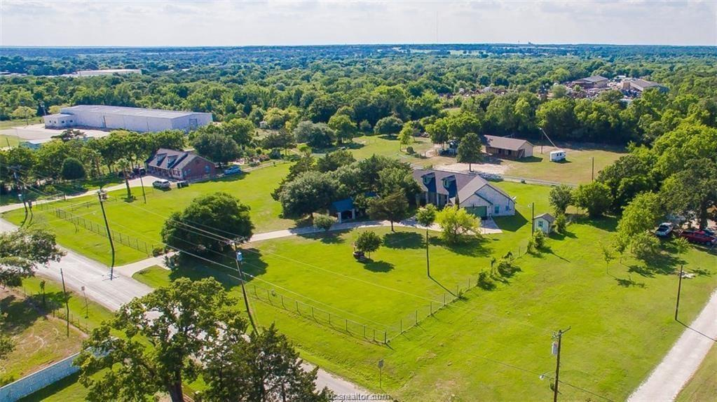 MOTIVATED SELLERS, NEEDING TO DOWNSIZE ASAP. City living with a country twist! Exceptional property with many amenities usually not found in the city PLUS an attached MOTHER-IN-LAW apartment with full kitchen, bathroom, living area and bedroom. This beautiful custom home sits on 3 acres & offers a 3-stall horse barn, ample outdoor storage, and is fully fenced with cross fencing making it animal ready, all on city sewer and water. The home offers a large covered front porch, open floor plan with 2,462 sqft, 3 bed/2 bath in the main part of the home with 1 bed/1 bath in the mother-in-law suite that could also be used as a game room or home office. The large living room boasts a vaulted ceiling that opens to the spacious kitchen with stained concrete flooring throughout. Additional features include a large dining room, formal dining, Utility room, & 2 car carport. Recent improvements: interior paint, updated cabinets, new HVAC, new roof, solar attic breeze fan, gutters & appliances.