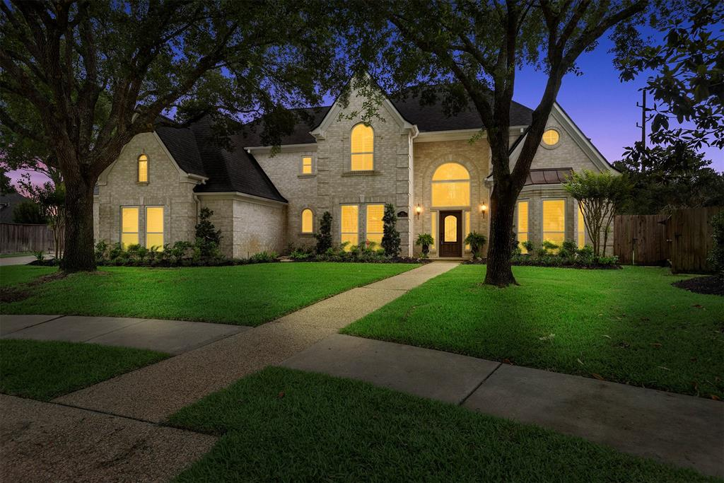 """Gorgeous remodeled home on an amazing 18,665 sq ft lot backing a greenbelt and George Bush Park. Park-like backyard with a 50' lap pool, screened gazebo & lush green yard! Hidden behind the fence is a slab for a RV or boat.  Recent roof (1 year) new double pane, Low-E windows, wood-look tile flooring in living areas, recessed lighting plus new light fixtures, ceiling fans & 6"""" baseboards. 364 sf room not included in square ft.  New kitchen features gorgeous soft-white Kent Moore cabinets w/soft-close doors, under-cabinet lighting, farmhouse sink, updtd Kitchen Aid stainless appliances, dbl convection ovens, commercial refrigerator, Sonic icemaker, 6 burner range & custom venthood.  Pantry w/custom shelving, built-ins, brick wall at breakfast area w/built-in hutch. Large breakfast rm overlooks the backyard. Remodeled primary bath, new frameless shower, vanities w/granite & tile flooring. Remodeled utility w/farm sink, built-in cabinetry. Upstairs baths updated. Plantation shutters."""