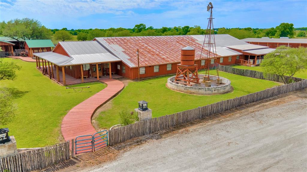 Beautiful and rustic 123+ acre property with home and event center.  Featuring a 13,000+ sf live music/entertainment facility, 4,000 sf banquet area with a kitchen, deck, patio and gazebo. There is also a smokehouse in the back for food preparation for events.  Outdoor amphitheater is near the ponds, located behind the event arena and equestrian show arena.  An additional building near the entrance to the property is a flex space perfect for restaurant or shop.