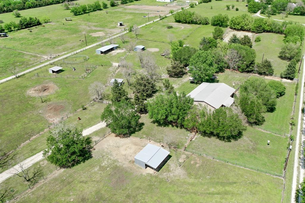 5 Acre Hobby Farm for Sale in Bryan, TX. Bring your horses and 4-H projects and call this country gem home! The 3 bed/2 bath, 1,700 sq/ft brick rancher features metal roof, enclosed sun room patio, attached garage, extra deep covered front patio, new laminate flooring, new paint, granite in the kitchen & lots of cabinets for storage. Anchored by this charming house, the layout of the property is incredibly functional offering 7 paddocks, all with loafing sheds and water, 3 stall shed row barn w/ enclosed feed room, small air conditioned shop with ample covered storage on two sides, 3 dog yards, electric solar powered front gate entry and much more. Welcome to the country life!