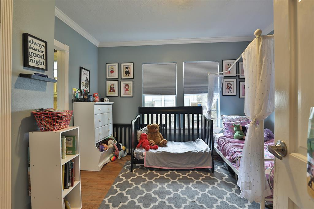 Secondary bedroom with door leading to private bathroom.