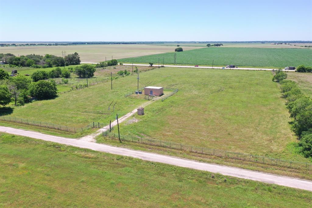 Nice rectangular shaped property on Hwy 60 just minutes from Bay City! Property has approx. 400 feet on Hwy 60 as well as 400 feet frontage on Guess Road. Property is fenced with a small building which could be turned into a small home. Has central A/C and heat as well as 2 back up generators. Owners recently gutted the building but it would have 3 rooms. One bedroom, a living area, and a bathroom. The property has a water well as well as a septic. Would be a great ranchette or possibly and R/V dealership. Would also make for a great boat storage. Many possibilities on this one!