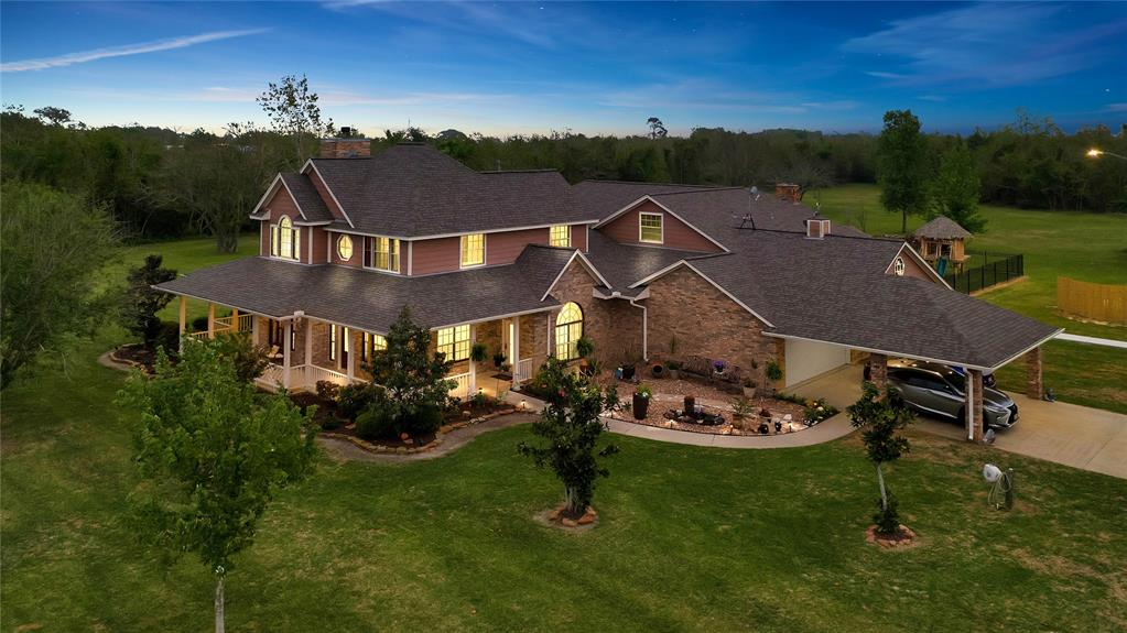 ONE OF A KIND LISTING IN BEACH CITY! Honey stop the car! This gorgeous 10.311 acres has it all. The home has a full mother-in-law house attached with flowing space in between. It has two pantries, two islands, his and her master baths, his and her closets. It is multi-family, multi-use, and potential extra income to be made. Also has a brand new roof. This is a property you don't want to miss. Outside you will find a fully stocked 2 acre lake and in the backyard you'll find your perfect oasis with an area to grill and lay out by the pool. Call today for your own private showing!