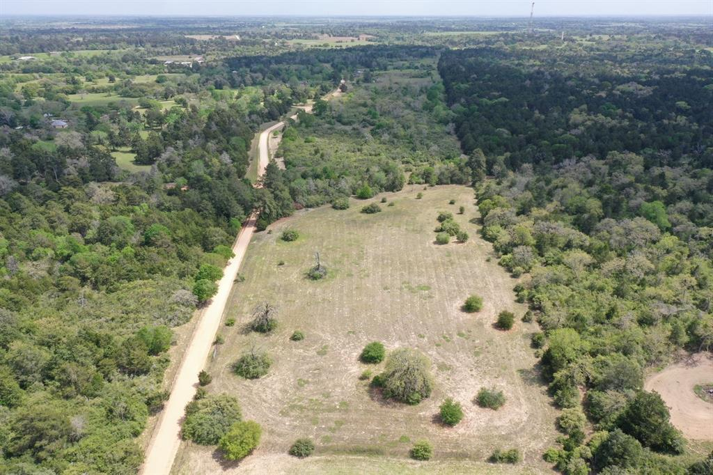 This 12-acre tract is part of a unique 30 acres paralleling Hall road and has a variety of native trees, and grasses intermixed throughout the property. This acreage has varied elevations, allowing future owners to position their home site in an extremely private manner, while still enjoying beautiful views. This property does convey minimal deed restrictions, to protect the charm of the surrounding area. Close by there is a historic old Dancehall and the Crossroads Tavern, with the nicest people in the world serving the best cold beer!   Available is an Austin County Water District water line along Hall road.