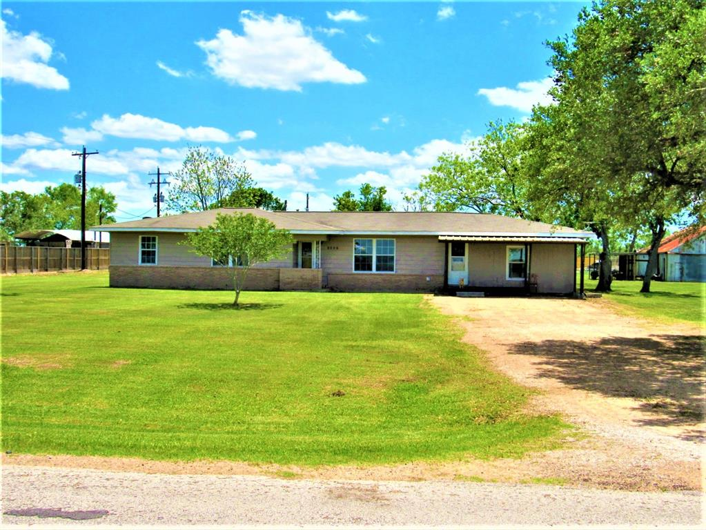 Check out out this great Country Home on 2 full acres with tons of huge shade trees, beautiful wood look aluminum siding and large 1,200 sq ft barn/workshop/mancave with it's own separate driveway, 4 big bedrooms, 3 on one side and the master with full bath, huge walk-in closet on the other with exterior door to it's own outdoor deck.     All new wood look vinyl plank flooring throughout, brand new decking and flooring in living room.  Check out that huge kitchen with beautiful granite look countertops and backsplash, soft closing cabinets and drawers and two pantries!   Large dining adjoins the kitchen with backdoor to one of your two outdoor decks.   New roof in 2012, new A/H in 2012, new water heater 2018, new water well tank 2012 and pump in 2018.  Stainless stove, dishwasher, fridge and above ground pool do stay.  Don't forget to check out the oversized mudroom/indoor utility with room for extra fridge/freezer.   This home has so much to offer.   Call fast before this gem is gone!